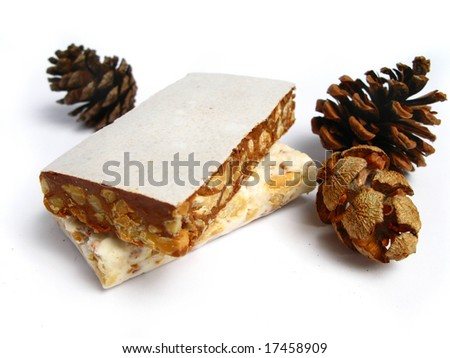 Nougat with pine cones on white background