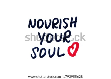 Nourish your soul! Handwritten message on a white background. Stock photo ©