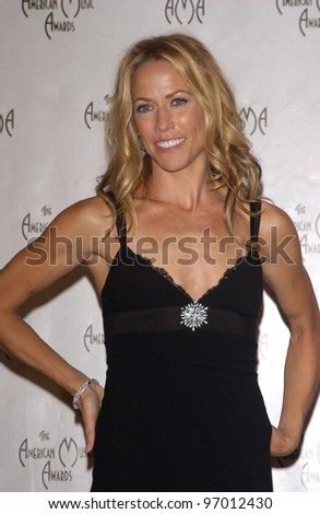 Nov 14, 2004; Los Angeles, CA: Singer SHERYL CROW at the 32nd Annual American Music Awards at the Shrine Auditorium, Los Angeles, CA. - stock photo