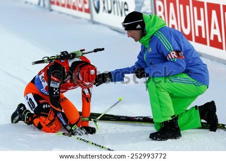 Nove Mesto na Morave, Czech Republic - February 7, 2015. Martin Otcenas gets medical help in finish at the Biathlon World Cup Sprint Men.
