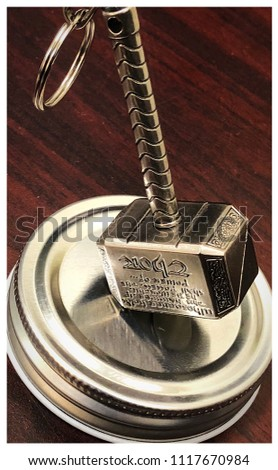 Novelty of Mjolnir, Thor's hammer. The inscription is in English; however, it is upside down. It reads: Whosoever holds this hammer, if he be worthy, shall possess the power of Thor. #1117670984