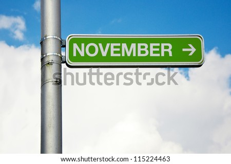 November. Direction street sign - November with arrow pointing to the right