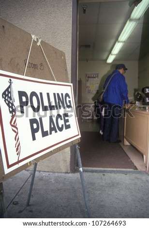 NOVEMBER 2004 - Election volunteers assisting voters in a polling place, CA
