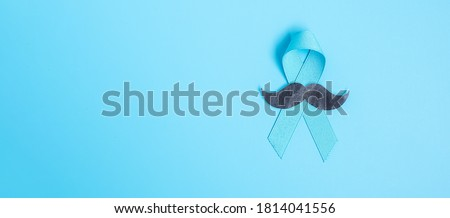 November Prostate Cancer Awareness month, light Blue Ribbon with mustache for supporting people living and illness. Healthcare, International men, Father and World cancer day concept Foto stock ©