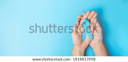 November Prostate Cancer Awareness month, Man holding light Blue Ribbon for supporting people living and illness. Healthcare, International men, Father, World cancer day and world diabetes day concept Stock photo ©