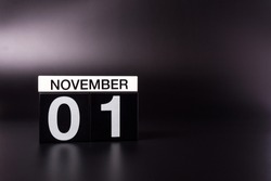 November 1st. Image of november 1 calendar on black background. Empty space for text