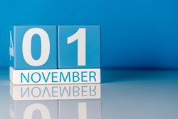 November 1st. Image of november 1 calendar on blue background. Empty space for text