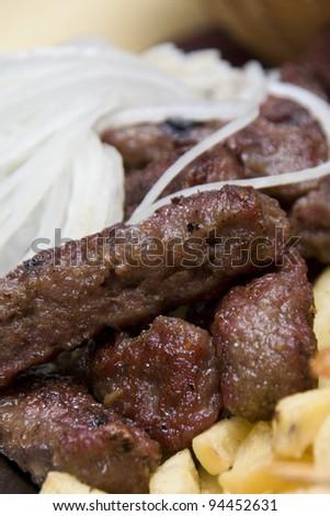 Novi Pazar kebab with fries and onion