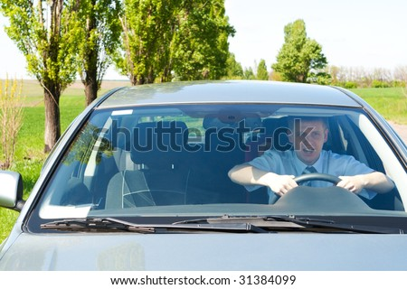 stock photo : Novice driver in a car