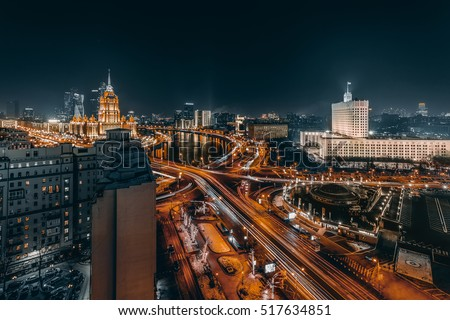 Novoarbatsky bridge, Government Building, Ukraine Hotel during night in Moscow #517634851