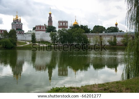 Novodevichy Convent reflects in the lake - landscape style. Overview picture of the New Maiden Convent