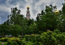 Novodevichy monastery garden and belltower in the background view.