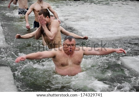 Novomoskovsk, Dnepropetrovsk region. Ukraine -19 January : religious holiday of Epiphany . People bathe in the river in winter Samara city Novomoskovsk Dnipropetrovsk region January 19, 2013 #174329741