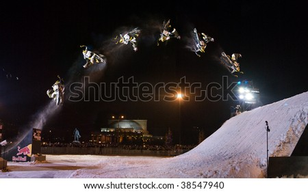 NOVOSIBIRSK - FEBRUARY 28: Breathtaking stunt on snowmobiles during the Red Bull Revolution on Machines event held on February 28, 2009 in Novosibirsk, Russia.