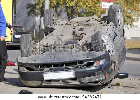 NOVOSIBIRSK - OCTOBER 11: Car accident on the road with participation of car. One has turned over October 11, 2009 in Novosibirsk, Russia