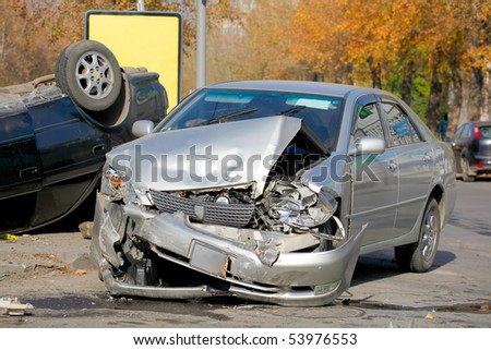 NOVOSIBIRSK - OCTOBER 11: Car accident on the road with participation of two cars. One has turned over October 11, 2009 in Novosibirsk, Russia