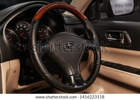 Novosibirsk, Russia - June 04, 2019:  Subaru Forester, close-up of the dashboard, speedometer, tachometer and steering wheel.Photography of a modern car on a parking in Novosibirsk