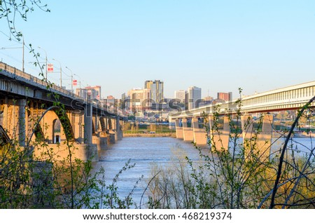 stock photo novosibirsk russia may a bridge across the river is on poles through the branches of 468219374 - Каталог — Фотообои «Новосибирск»