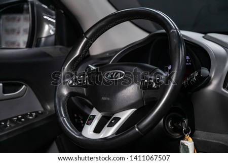 Novosibirsk, Russia - May 28, 2019:  Kia Sportage, close-up of the dashboard, speedometer, tachometer and steering wheel.Photography of a modern car on a parking in Novosibirsk