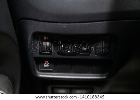 Novosibirsk, Russia - May 28, 2019:  Nissan Juke, close-up of the  buttons: side mirror  and headlight adjustment buttons. Photography of a modern car on a parking in Novosibirsk #1410188345