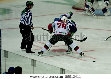 NOVOSIBIRSK - SEPTEMBER 26:  Ice hockey, the game between Siberia and AK Bars, Lehterya Yori (Sib) and Jarkko Immonen (AkB), fighting for the puck is dropped on September 26, 2011, Novosibirsk Russia