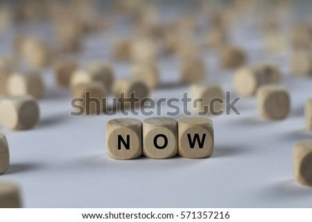 now - cube with letters, sign with wooden cubes