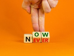 Now or never symbol. Businessman turns wooden cubes and changes the word 'never' to 'now' or vice versa. Beautiful orange background, copy space. Business and now or never planning concept.