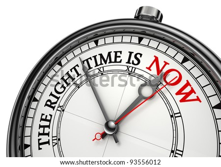 now the right time concept clock closeup on white background with red and black words