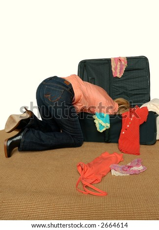 Now Where Is  My Passport? - A woman is digging deep into the dark recesses of her travel bag, looking for something.