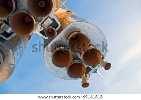 Nozzles space rocket Soyuz. Close-up on a background of clear blue sky. - stock photo
