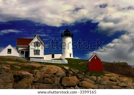 Nubble Lighthouse, Cape Neddick, Maine, with dramatic cloudy skies