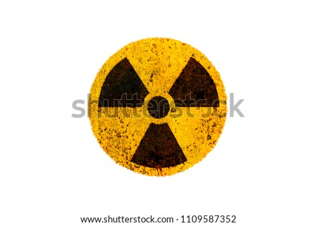 Nuclear energy radioactive (ionizing radiation) nuclear round yellow and black danger warning symbol on rusty metal grungy texture and isolated on white background.