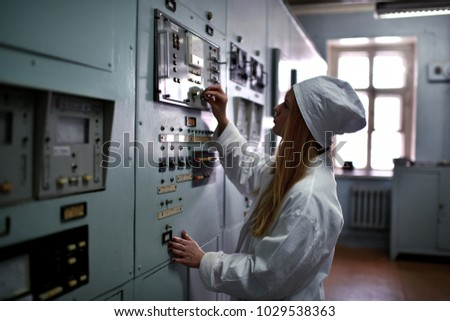 Nuclear plant engineer woman working at thermal power plant appliance device  #1029538363