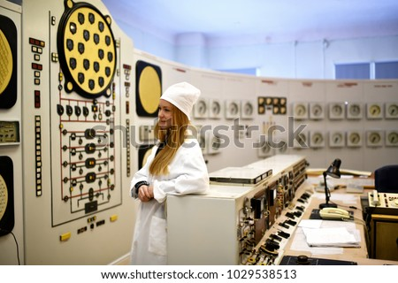 Nuclear plant engineer woman working at thermal power plant appliance device  #1029538513