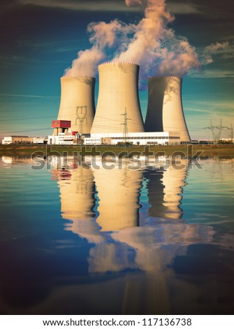 Nuclear power plant on the coast. Ecology disaster concept. - stock photo