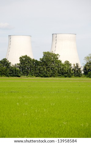 nuclear power station in rural area; vertical composition, large copy-space at the bottom; daylight.