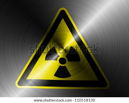 Nuclear radiation sign drawn on brushed metall