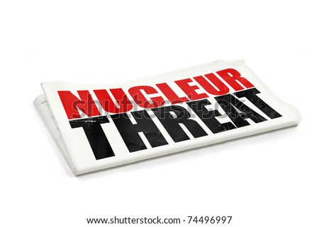nucleur threat headline on a newspaper isolated on a white background