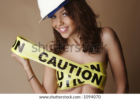 "Nude female smiling, wearing a construction hard hat and with breasts covered by yellow ""caution tape"""