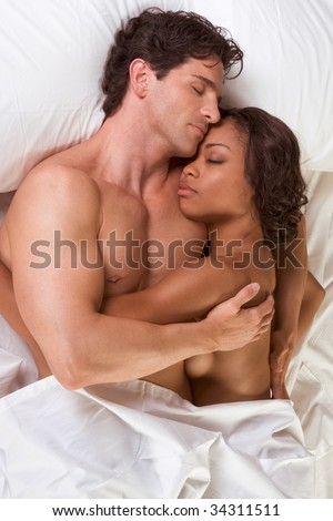 stock photo : nude heterosexual couple in bed peacefully sleeping in ...