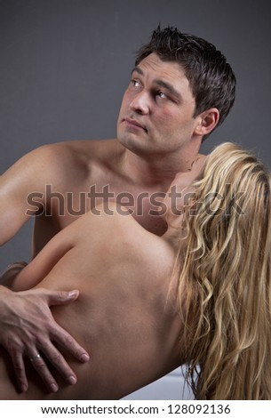 Nude Loving Couple - Shot in Studio over grey background