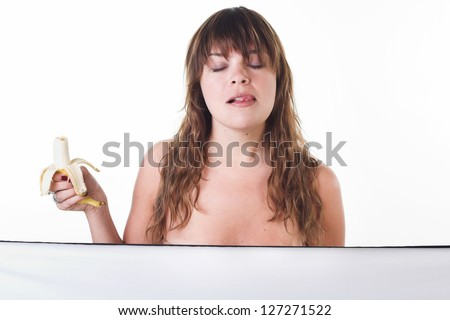 nude portrait of the girl eating banana