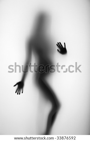Nude pregnant girl behind a diffuse surface