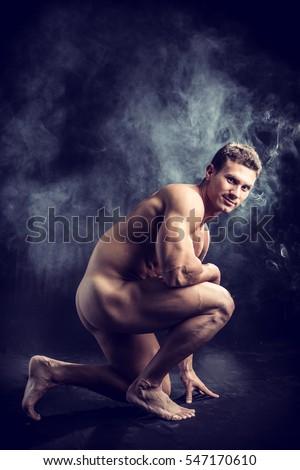young nude girl crouching