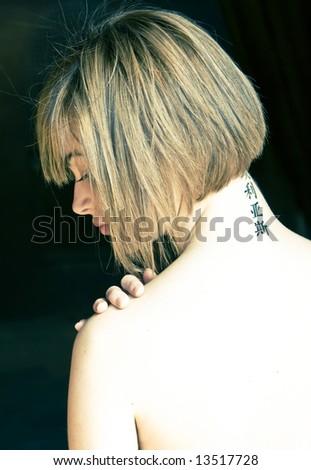Nude shoulder in woman portrait, cross processed, high key