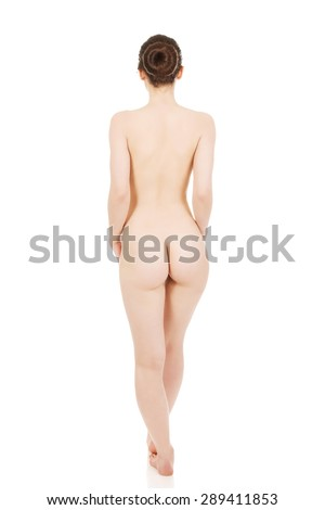 Nude woman standing back to camera