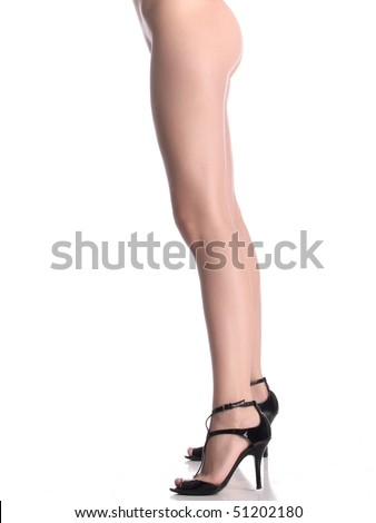 stock photo : Nude woman with long legs standing in high heels