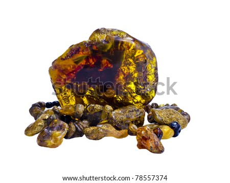 Nugget and beads of amber isolated on white background