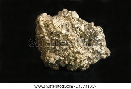 Nugget of mineral iron pyrite also known as fool's gold because of its resemblance to gold. Concept for business, wealth, greed, mining or geology.