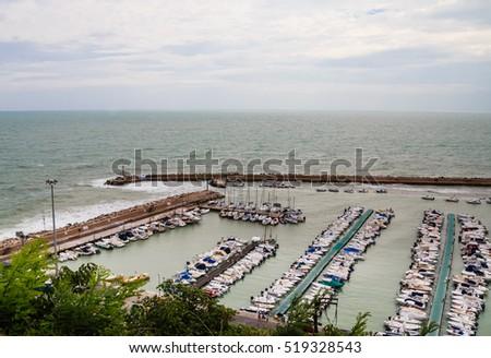 Numana, Italy - September 7, 2016: Marina at the harbour front of Numara, Marche, Italy #519328543